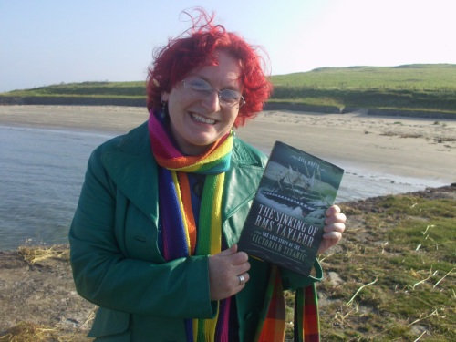 Gill Hoffs with Tayleur book on Lambay - harbour